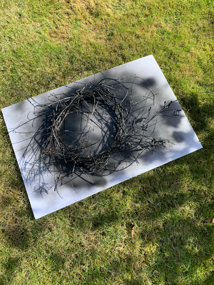 black spray paint on stick wreath