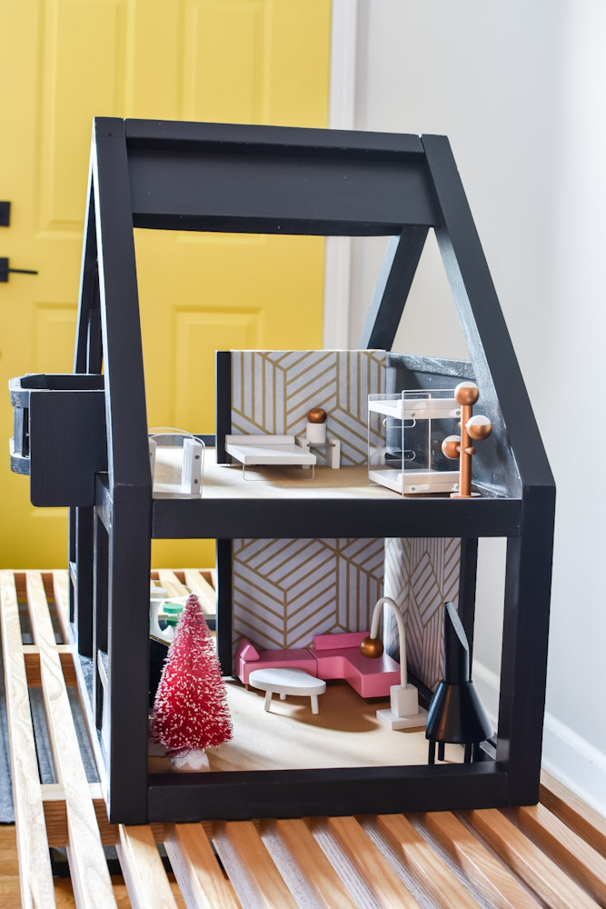 painted dollhouse with furniture