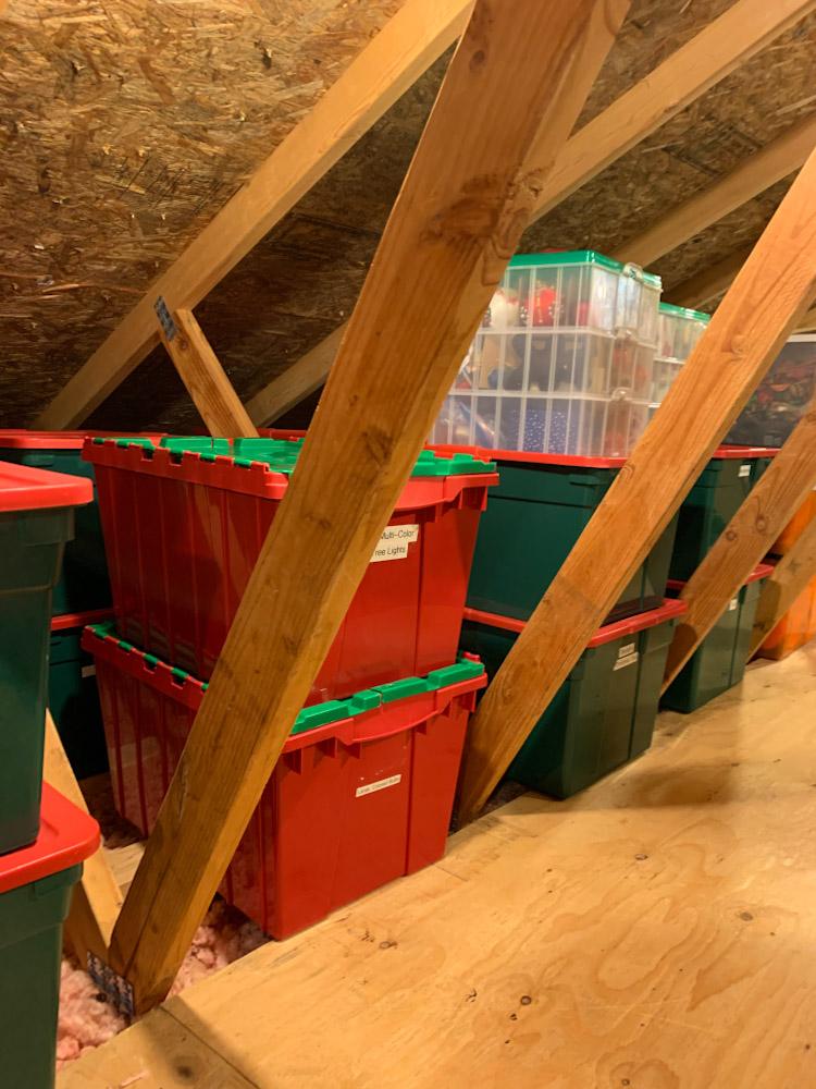 organized christmas bins in attic