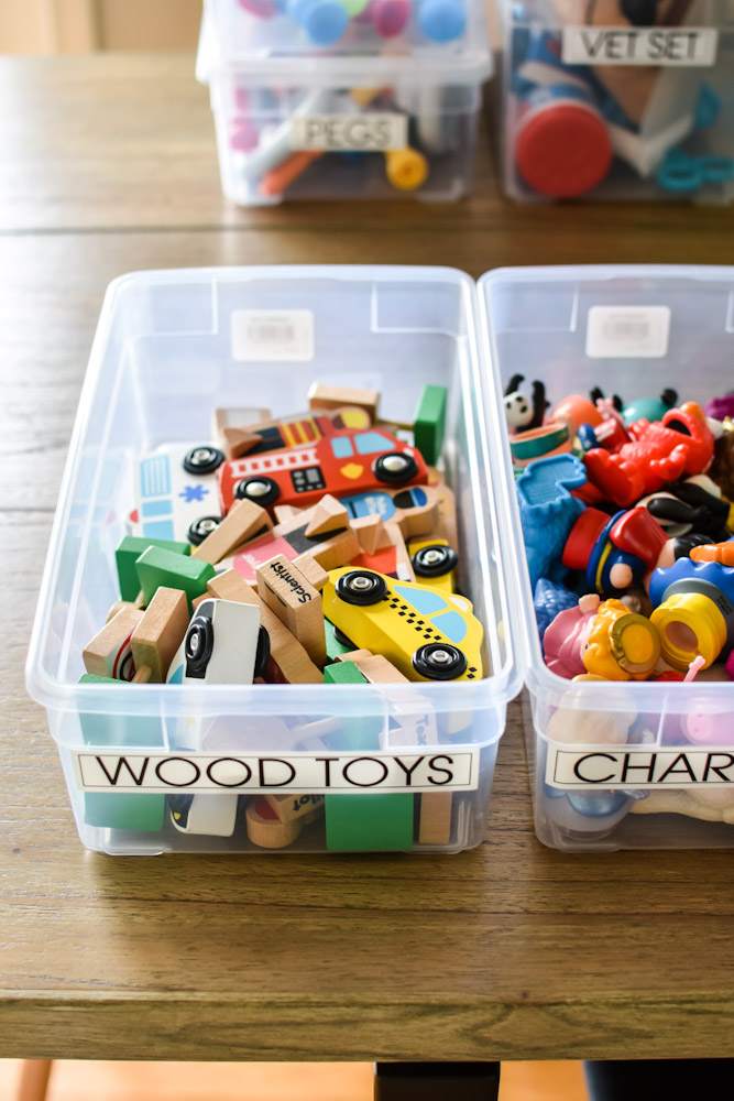 clear toy bins with wood toys