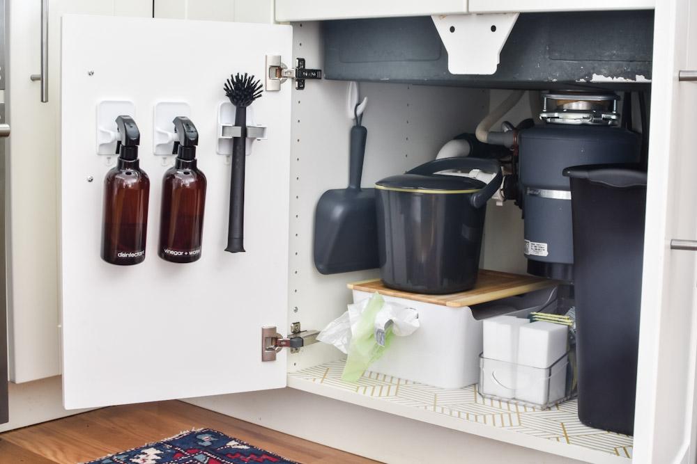 organized under the sink cabinet