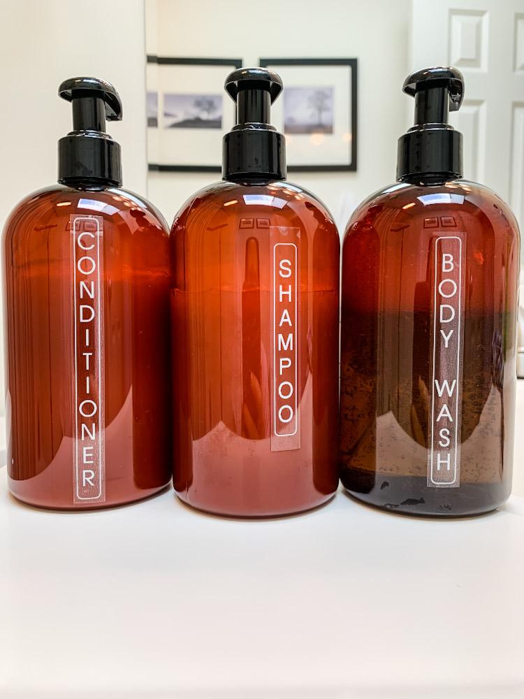 amber plastic labeled shampoo bottles