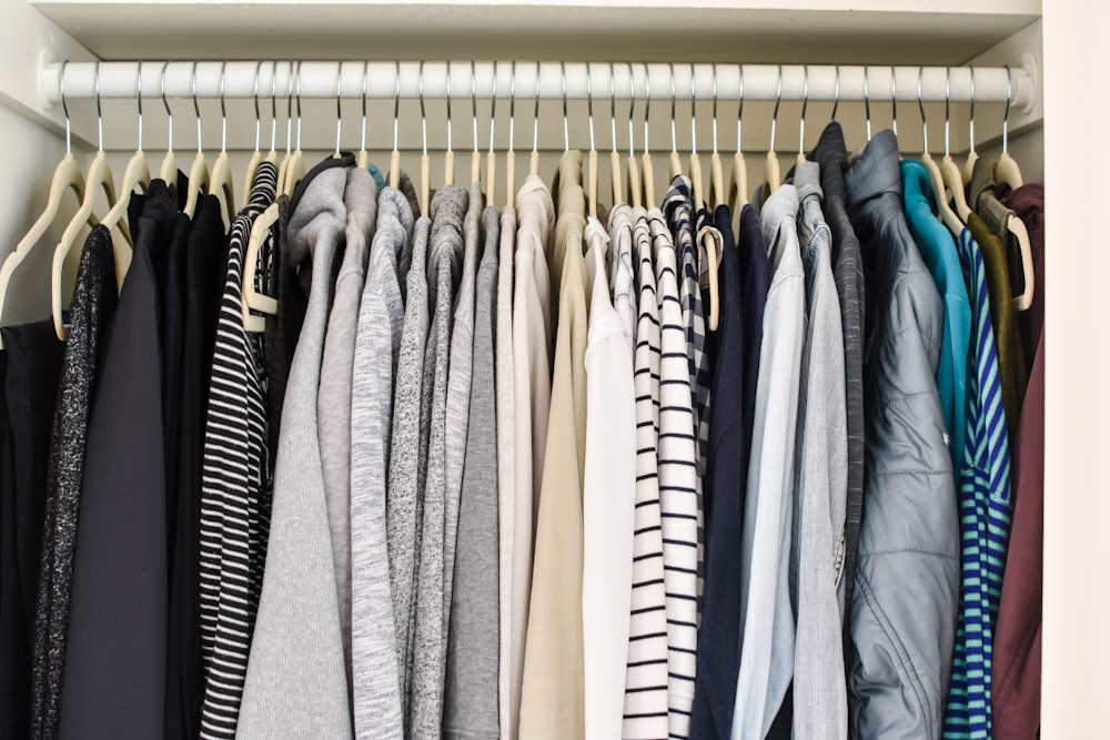 hanging clothes in a closet