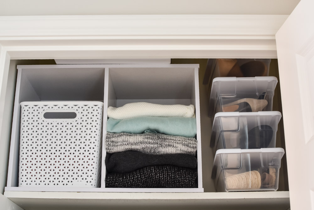 Organized closet shelf with sweaters and shoes