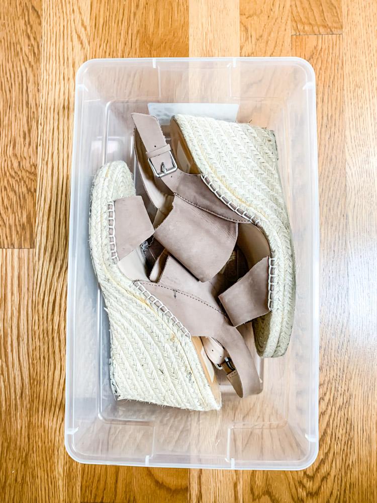 wedge shoes in a clear bin