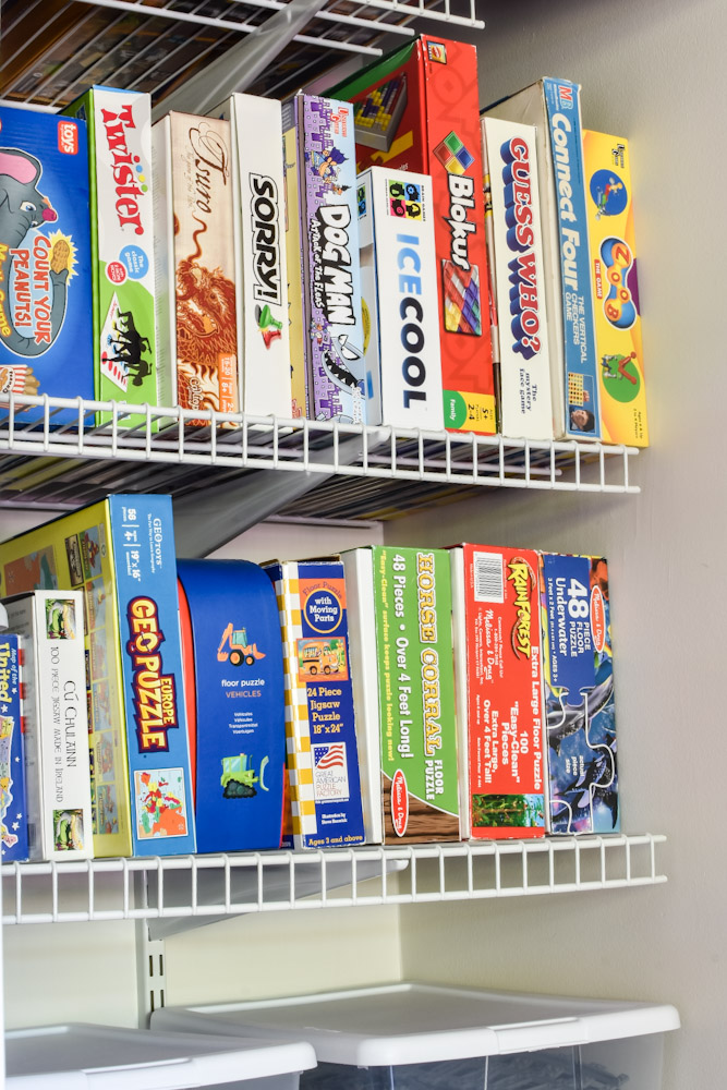 games and puzzles stored vertically on shelf