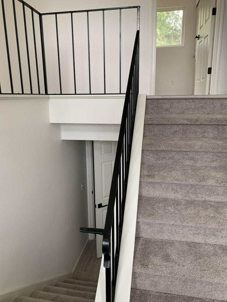 split level black railing on stairs